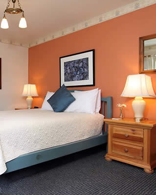 Located in the Water Tower. Tucked away on the first floor, this is a cozy Queen bed room with charming country decor.