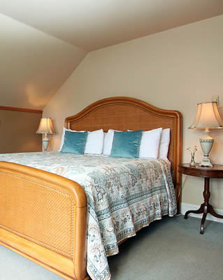 guest room with bed and side tables